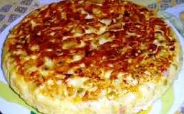 Tortilla Preñada con Queso Rallado